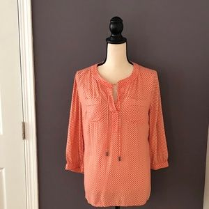 Coral and cream patterned flowy blouse